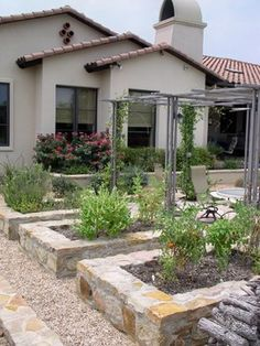 """According to the very talented landscape architect, Curt Arnette of Sitio Design (Austin, Texas) it is comprised of a base of decomposed granite topped with 1-1/2"""" of 3/8"""" pea gravel.  Stone is Native Texas Limestone."""