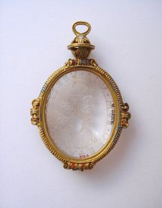 Intaglio; rock crystal; bust of Christ to left; mounted in reverse, inscribed; in enamelled gold pendant mount with pierced sphere and loop for suspension; traces of enamel. Date:      16thC(late).