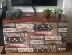 TV cabinet with suitcases wallpaper on the doors