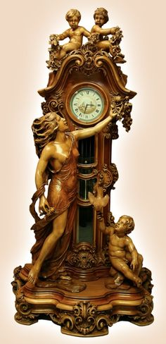 Eternal Love - Timeless Beauty. Hand carved by a master carver from the age of 80-91 years old. It took the artist over eleven years to finish this this timeless piece of art. The clock is carved out of walnut.