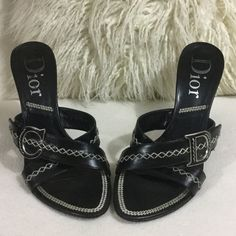 """Authentic Dior black leather sandal wedges Authentic Dior black leather sandal wedges. Suede wrapped 4"""" wedge heel with gorgeous contrast stitching detail. Large leather and silver metal C and D logo on each shoe. These have been gently loved with some slight wear and some light scarring to heels as seen in pic otherwise good condition. And designer shoes at a fraction of the price. Shoe states size 40 would fit 8.5 great. Insoles measure 10 1/4"""" long for reference Dior Shoes Wedges"""