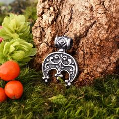 Pendant-talismn Lunnitsa Jewelry-amulet with pearls and ceramic cabochon in the shape of the face of the moon Pendant in Victorian style.