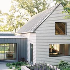 I can never decide which I love most - a white or dark charcoal house. This is the best of both worlds and a look I could love forever. Where do you fall on the exterior paint color discussion - light or dark? Charcoal House, Modern Barn House, Modern Farmhouse Exterior, Residential Architecture, Architecture Details, House Colors, Curb Appeal, Exterior Design, Exterior Paint
