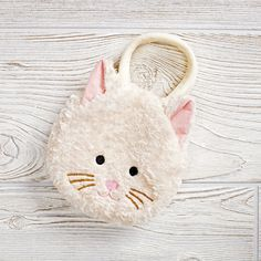 Shop Cat Goody Bag Purse.  Our Cat Goody Bag Purse is plush and roomy enough to hold small treats and treasures.  And it's guaranteed to never hiss at you.