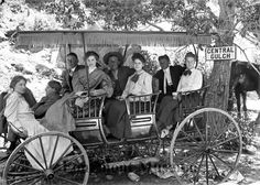 Photograph from between 1900 and 1920 of eight people in a surrey with fringe. Surrey style carriages often had only two rows of seating; this one has three.  (Longmont Museum & Cultural Center)