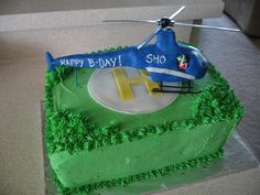 Helicopter Birthday Cake - I made this cake for a client who was turning 40 and had just got his pilot license. I made the helicopter out of Wilton candy clay and put it on top of a marble cake base with buttercream icing.