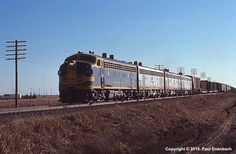 ATSF #223 (EMD F7) leaving Oklahoma City in the evening of March 5, 1972. Photo by Paul Enenbach.