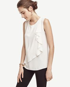 """A cascading side ruffle styles this piece with an irresistible touch of breezy elegance. Jewel neck. Sleeveless. Front ruffle overlayer. Back keyhole with hook-and-eye closure. 25 3/4"""" long."""
