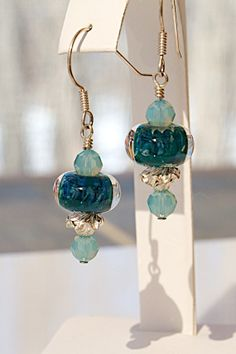 Pin it if you love it! Handcrafted artisan earrings with lampwork glass beads by 5 Fish Designs. Accented with Swarovski crystals and sterling silver beads. Designed by Joann Hayssen SRA $28.00 - 20% of the purchase price will be donated to Rosemary Farm horse rescue and sanctuary! https://www.etsy.com/listing/188852130/lampwork-glass-earrings-swarovski?ref=shop_home_active_1