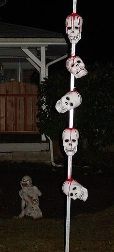 Skulls on a pole dollar store and easy. If the pole was decoupaged or stained it would look better.