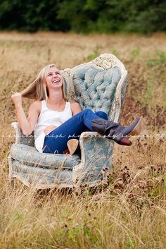 Chair in a field for senior pictures. Not a fan of her pose/goofy grin/hair pull....but the basic idea is cute!