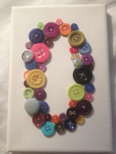 O for Oliver - mix of vintage and new buttons on canvas