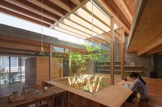 Shrimp is a minimalist house located in Hiroshima, Japan, designed by UID Architects. The house is separated into three volumes focused around a central internal courtyard. The three volumes are l…