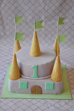 Simple idea, circle cake on square with cones & flags. Make prettier! castle cake
