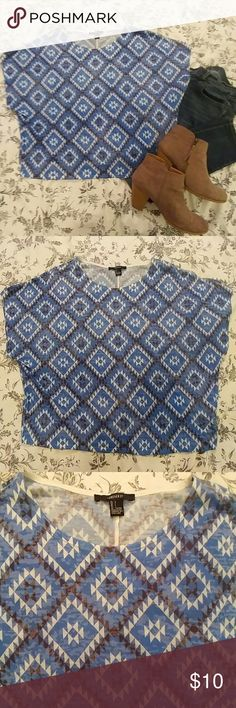 Forever 21 tribal top Forever 21 blue, white and black tribal top. Size Large, loose fit. Great condition, worn twice. Shoes not included. Jeans sold separately. Forever 21 Tops Tees - Short Sleeve