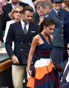 Stylish: David and Victoria catch a few eyes as they sit down in the Royal Box at Wimbledon