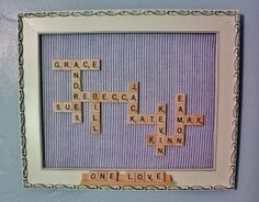 Family names made with scrabble tiles in a frame
