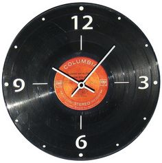 Clock made from an old vinyl record. #Hipcycle