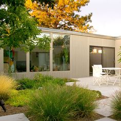 "Mid-century Modern landscape by Strell Design. ""To soften the stark lines of a classic 60's residence, the front yard, anchored by a mature conifer, utilizes grasses, yuccas, hyssop, and nandina to soften the lines and materials of this modern house. The rear, side yards and interior courtyard continue the balance of structured organization to contain and highlight the texture and wild beauty of grasses and perennials."" #yard #backyard #patio #landscape #garden"