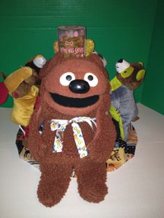 "Rowlf the Muppet towel cake filled with doggie toys and treats.  An actual vintage ""Rowlf"".  Toys for the pets and items for the ""Master""."