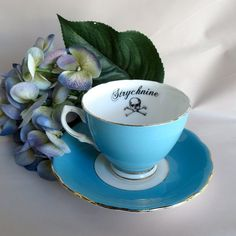 So very cool. Tea time with a serious edge...Strychnine Gothic Poison Tea Cup and Saucer by AustinModern, $38.00