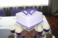 Hearts were so effective in dressing up the wedding cupcakes. These cupcakes were piped with a rose swirl using a 1M tip. They were finished off with a tiny purple heart. The cupcakes came in Red Velvet with Vanilla buttercream and Cookies with Chocolate buttercream.