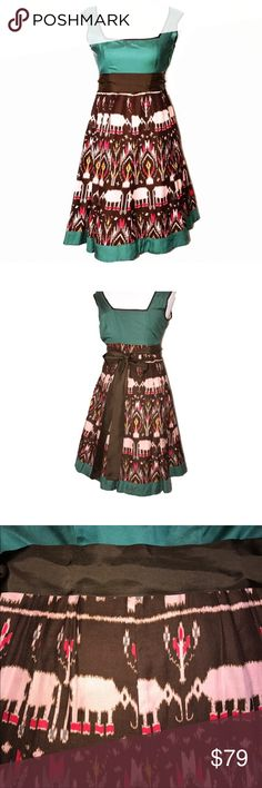 Anthropologie Pink Elephant Silk Blend Dress Anthropologie Diodore midi dress. Gemstone green and brown with light pink watercolor elephant print. Fit and flare, empire waist. Silk and cotton blend. Small cap sleeves, square neckline, silk ribbon can be tied in front or back. Fully lined, side zipper.  Great condition Anthropologie Dresses Midi