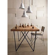 """A new table at CB2. Love the skinny iron """"w"""" legs w/wood plank combo."""
