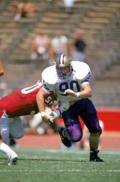 Steve Emtman of the Washington Huskies runs on the field against the Stanford Cardinals at Stanford Stadium in September 7 1991 in Stanford...
