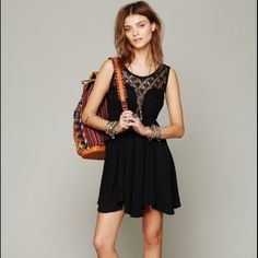 Free People Black Fiesta Lace Dress Small Free People Black Fiesta Dress This Free People dress is easy breezy, featuring an empire waist, and crotchet upper front and back. Worn one time- perfect condition. Free People Dresses