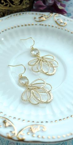 Clear Glass Gold Feathers Earrings, Gold Bridal Wedding Dangle Earrings, Gold Feathers, Bridesmaids Gift. Gold Wedding by Marolsha -  https://www.etsy.com/listing/202514027/clear-glass-gold-feathers-earrings-gold?ref=shop_home_active_2