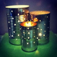 For this project, I took the labels off some tin cans using hot water and elbow grease. Then I drove nails through the can with a piece of wood behind it (so as not to crush the can). Finally, I added candles. Ta-da!