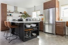 Whether through the use of wood, granite, or cement, minimalist kitchens are defined by sleek. Get familiar with the kitchen design idea that isn't going away.