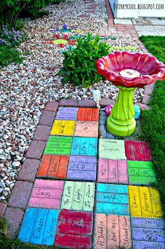 Quirky Cool: Recycled bricks from an old fireplace turned into colorful yard art!