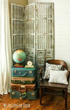 My Passion For Decor: My Family Room Plank Wall And a Clean Up Dream! - loving the room divider and stacked suitcases