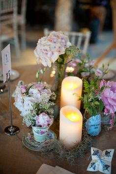 An example of how flowers and candles work well together.