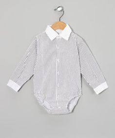 Made from soft cotton, this bodysuit is cozy on delicate skin. Classic buttons and a pointy collar add a fun, stylish touch, while handy snaps make slipping that handsome boy into dapper style simple.