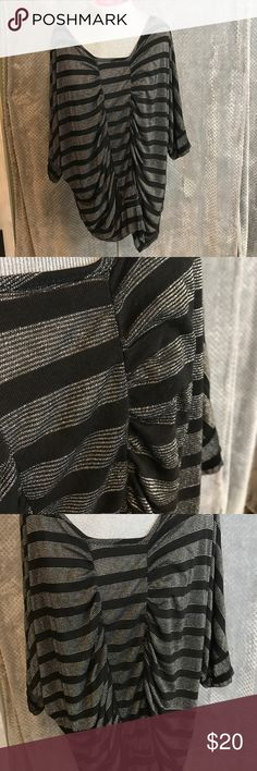 """Rhapsody dolman sleeve silver metallic top Great party top for the upcoming holidays. Long enjoy fb to wear with leggings. It's sheer so you will need a tank!  Bust23"""". Length 30"""" Rhapsody Tops Tunics"""