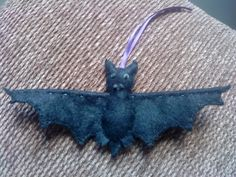 Bat with wire in the wings so they can be positioned.