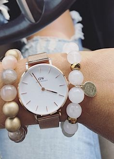 Daniel Wellington rose gold watch stack and distressed jeans || wrist candy inspo || Instagram: @SheaLeighMills