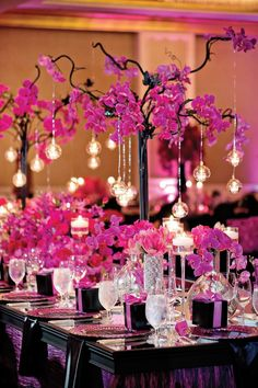 Photographer: Milanes Photography via Muna Luchi Bridal; Pink wedding centerpiece;