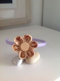 My first try on a kanzashi flower. A headband for my girl.