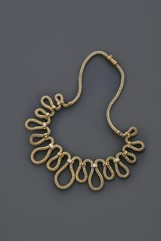 1960s gold and diamond swirl necklace.