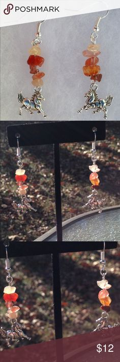 Fire Agate Horse Sterling Silver Plated Earrings These lovely earrings are made with natural fire agate in varying shades of red. The horse charms are silver tone, and the hooks are sterling silver plated.   All PeaceFrog jewelry items are handmade by me! Take a look through my boutique for more unique creations. PeaceFrog Jewelry Earrings