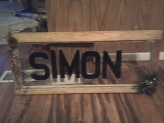 country style window I made and sanded put varnish on added hooks and painted