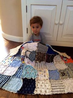 This is a site where you can have a quilt made from your baby's clothing, but I think I could DIY this. Cute idea.