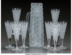 A CUT-GLASS PITCHER AND EIGHT CUT-GLASS STEMS, 20th century 11-1/4 inches high (28.6 cm) (pitcher). Cut Glass, Glass Vase, Glass Pitchers, Pressed Glass, Carnival Glass, Early American, Stems, Cool Art, Perfume Bottles