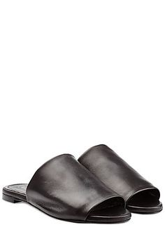 In smooth black leather with an unfussy silhouette, these slip-on sandals from Robert Clergerie  are a minimalist favorite #Stylebop