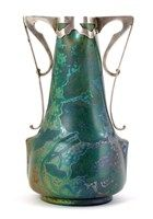 A Clement Massier Golfe Juan vase with silver mount, the shouldered body with tapering neck, painted with cyclamen leaves in a green lustre glase, with Art Nouveau silver twin handled mount