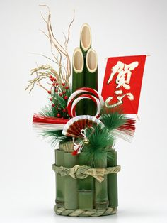 Oshogatsu (New Years) decoration. The Kadomatsu are decorations made with assembled pine branches enhanced by stems of bamboo and sprays of plum trees. A pair of them, one for each side, is normally placed in front of the house gate. In Japan pine, bamboo, and plum trees are considered good luck, pine in particular has held the meaning of longevity and valued since ancient times.